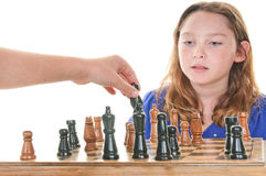 Girl watching next chess move Stock Photography