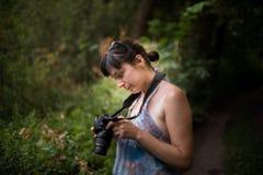 Girl watching. Nice girl watching photos taken in the camera Royalty Free Stock Image