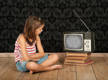 Girl watching old tv Royalty Free Stock Image