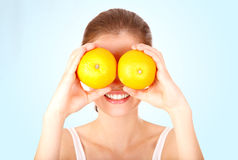 Girl watching with oranges stock photos