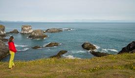 Girl watching over coastline of Snaefellsnes peninsula Royalty Free Stock Photos