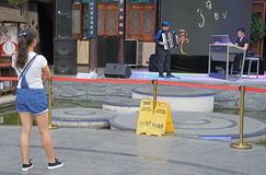Girl is watching a performance in Kunming, China Stock Photo