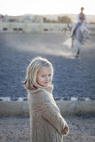 Girl watching a riding lesson stock photography