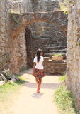 Girl watching ruins of castle Pecka Royalty Free Stock Photos