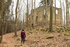 Girl watching ruins of the chapel of St. Mary Magdalene royalty free stock photography