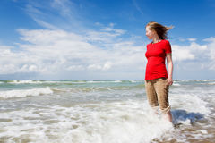 Girl watching the sea. Girl in red shirt watching the sea Royalty Free Stock Photos