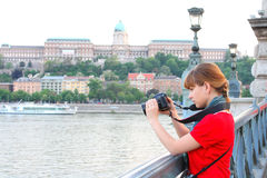 Girl watching at the shoot in the DSLR camera Stock Photo