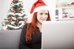 Girl is watching something on the laptop Stock Image