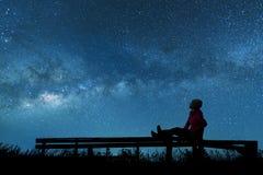 Girl watching the stars. In night sky Stock Image