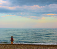 A girl watching sunset. A girl watching beautiful sunset from seashore Royalty Free Stock Photography