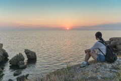 Girl watching the sunset over the sea. Crimea. Royalty Free Stock Photography
