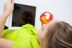 Girl watching tablet PC computer Stock Photography