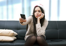 Girl watching television Stock Photo