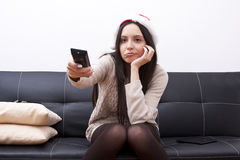 Girl watching television Stock Images
