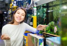 Girl watching tropical fish Royalty Free Stock Images