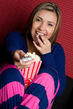 Girl Watching TV. Eating popcorn Stock Photos