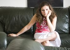 Girl watching tv. A girl sitting and watching television Royalty Free Stock Images