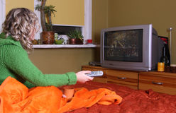 Girl is watching tv Stock Photography