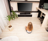 Girl watching TV at home Royalty Free Stock Photo