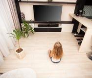 Girl watching TV at home Royalty Free Stock Photo