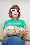 Girl watching TV movies in 3D stereo glasses Stock Image