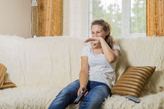 Girl watching TV Royalty Free Stock Photos