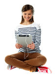 Girl watching video on her tablet Royalty Free Stock Photos
