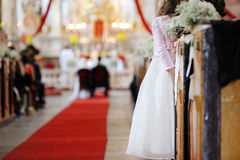 Girl watching a wedding ceremony Stock Photography