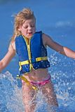 Girl in the Water. Young girl splashing and playing in the water Stock Photos