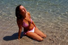A girl in water on Adriatic beach Royalty Free Stock Photography