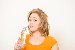 The girl with a water bottle Royalty Free Stock Images