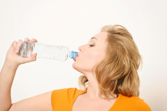 The girl with a water bottle Stock Images