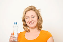The girl with a water bottle Royalty Free Stock Image