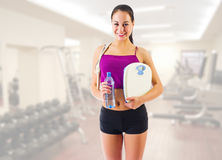 Girl with water bottle and skipping rope at gym club Stock Photos