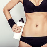 Girl with water close up. Fitness girl with water close up Royalty Free Stock Photo