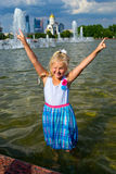 Girl in the water at the fountain Stock Photography