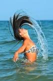 Girl water fun Stock Images