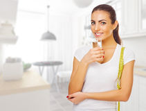 Girl with water glass at light room Stock Photos