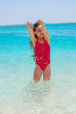 Girl in Water on an Island Stock Photo