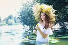 Girl with water lily Royalty Free Stock Images