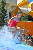 Girl in the water park Stock Image
