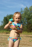 Girl with water pistol Stock Images