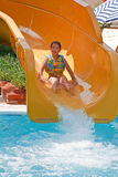 Girl on water slide Stock Photos