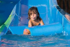 Girl on the water slide Stock Photos