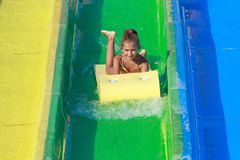 Girl on the water slide Stock Image