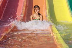 Girl on the water slide Royalty Free Stock Image