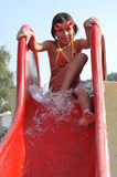 Girl on water slide Stock Photo
