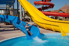 Girl in  water slide at aquapark Stock Photo