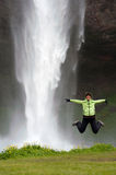 Girl and waterfall Stock Photography