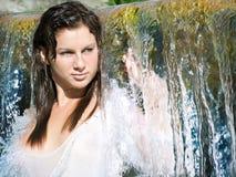 Girl at waterfall Stock Photo